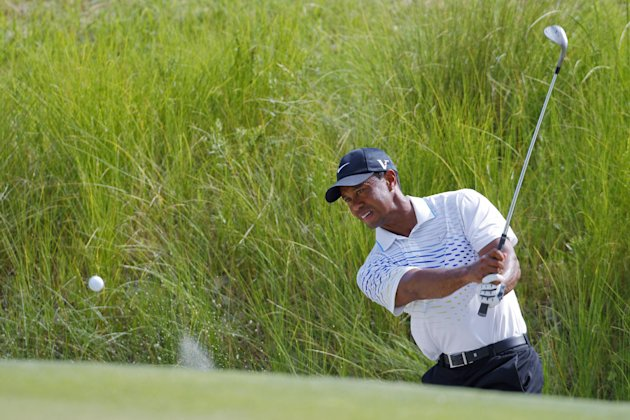 Tiger Woods chips tp the seventh green during the third round of the PGA Championship golf tournament on the Ocean Course of the Kiawah Island Golf Resort in Kiawah Island, S.C., Saturday, Aug. 11, 2012. (AP Photo/Chuck Burton)