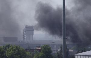 Smoke rises from the airport outside Donetsk, Ukraine, …