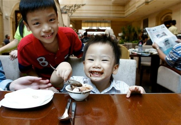 Watch your kid's table manners!