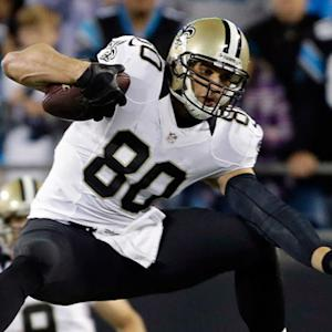 New Orleans Saints tight end Jimmy Graham jumps over Carolina Panthers safety Roman Harper and gains 19 yards