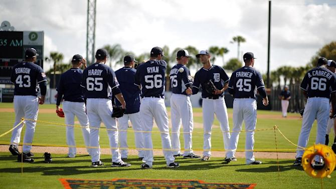 Detroit Tigers pitchers stand on the third baseline during a drill at Joker Marchant Stadium before a spring training exhibition baseball game against the Baltimore Orioles in Lakeland, Fla., Tuesday, March 3, 2015. The logo painted on the field celebrates the 50th year of Detroit Tigers spring training being held at Joker Marchant Stadium and Tiger Town in Lakeland, Fla. (AP Photo/Gene J. Puskar)