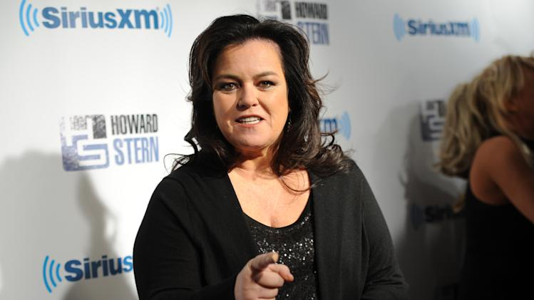 "FILE - This Jan. 31, 2014 file photo shows television personality Rosie O'Donnell attends ""Howard Stern's Birthday Bash,"" presented by SiriusXM in New York. ABC said Thursday, July 10, 2014, that O'Donnell will return to ""The View,"" whose couch is nearly empty with the on-air retirement of show creator Barbara Walters and impending departures of Jenny McCarthy and Sherri Shepherd. (Photo by Evan Agostini/Invision/AP, File)"