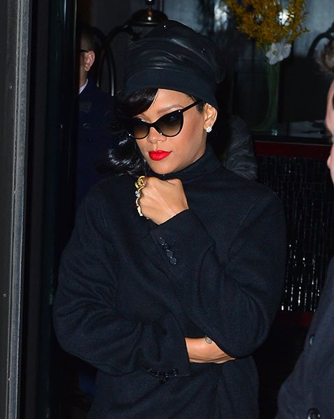 Rihanna makes her way to her NYC show - Bundled against the cold, RiRi is ever-glamourous in a leather hat, gigantic diamond studs, Tom Ford shades, loads of rings and matte red lips.