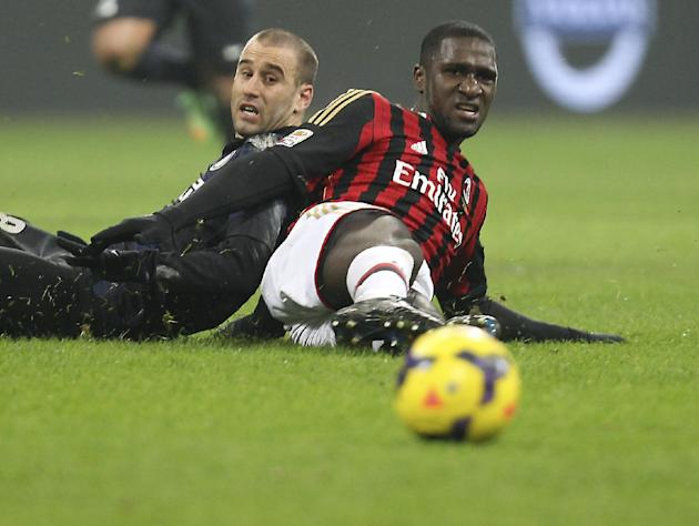 AC Milan defender Cristian Zapata, right, of Colombia, and Inter Milan forward Rodrigo Palacio, of Argentina, watch the ball, during a Serie A soccer match at the San Siro stadium in Milan, Italy, Sun