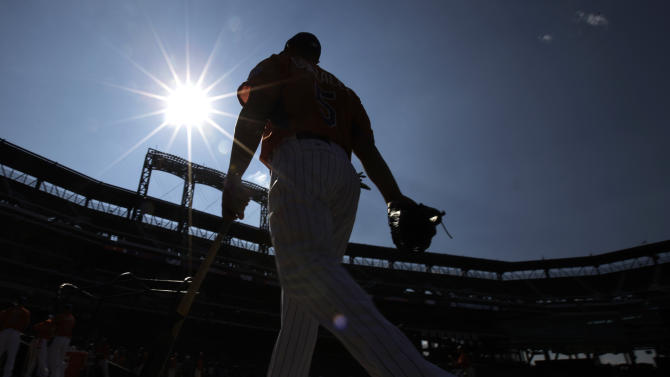 National League's Carlos Gonzalez, of the Colorado Rockies, walks to the batting cage before the MLB All-Star baseball game, on Tuesday, July 16, 2013, in New York. (AP Photo/Matt Slocum)