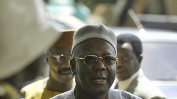 FILE- In this file photo dated Friday Sept. 30, 2005, Sierra Leone president Ahmed Tejan Kabbah arrives at the venue of the Ivory Coast talks in Abuja. The 82-year old Kabbah, who oversaw the end of the country's brutal 10-year civil war, has died Thursday March 13, 2014, at home in Freetown, the capital of Sierra Leone.(AP Photo/George Osodi, FILE)