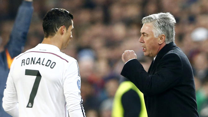 Real Madrid's coach Ancelotti talks to Ronaldo during their Champions League Group B soccer match against FC Basel in Basel