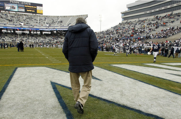 FILE - In this Nov. 27, 2010, file photo, Penn State coach Joe Paterno walks on to the field at Beaver Stadium for warm ups before an NCAA college football game against Michigan State in State College