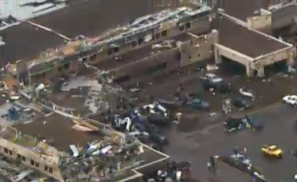 CORRECTS TORNADO MEASUREMENT TO NUMBER REPORTED BY THE NATIONAL WEATHER SERVICE - This frame grab courtesy of KFOR TV shows the aftermath of a massive tornado as much as half a mile wide with winds up to 200 mph roared through the Oklahoma City suburbs Monday, May 20, 2013. (AP Photo/Courtesy KFOR TV)