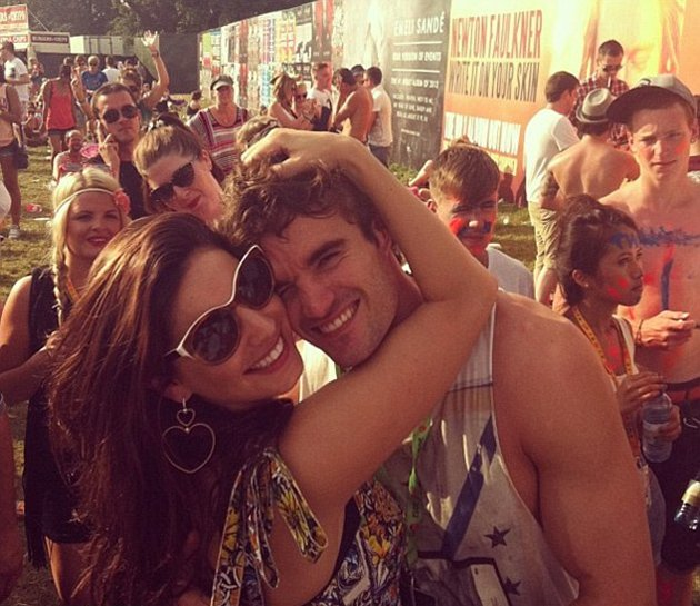 Kelly Brook and Thom Evans looked seriously loved up. Copyright [Kelly Brook] Kelly Brook tweeted a gorgeous photo of her and boyfriend Thom Evans at V Festival over the weekend.