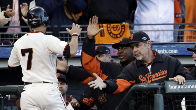 San Francisco Giants manager Bruce Bochy congratulates Gregor Blanco (7) after scoring from second on a hit by Matt Cain during the second inning of Game 7 of baseball's National League championship series against the St. Louis Cardinals Monday, Oct. 22, 2012, in San Francisco. (AP Photo/David J. Phillip)