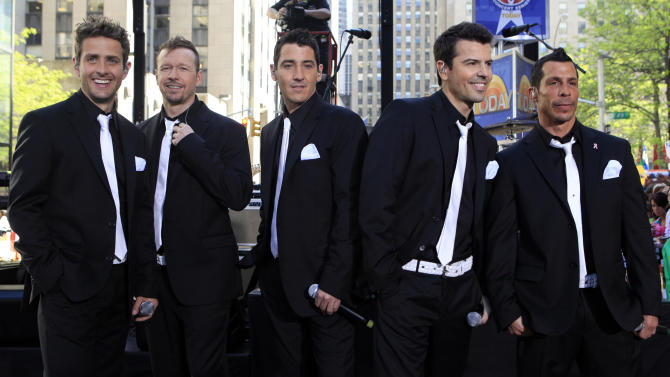 """FILE - This May 8, 2009 file photo shows members of New Kids on the Block, from left, Joey McIntyre, Donnie Wahlberg, Jonathan Knight, Jordan Knight, and Danny Wood on the NBC """"Today"""" television program in New York. The New Kids on the Block, Aerosmith, James Taylor, and Jimmy Buffett are among the scheduled performers for a Boston Marathon benefit concert May 30. The show, at the TD Garden, will benefit One Fund _ the collection of donations that will be distributed to the survivors of the April 15 bombings and the families of those killed in the attack.""""  (AP Photo/Richard Drew)"""