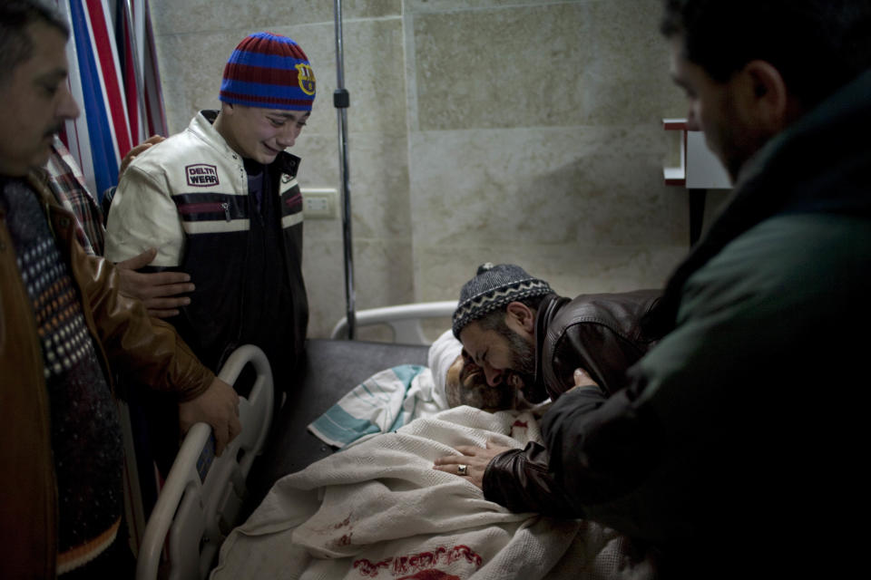 Relatives mourn the death of a relative moments after his death, killed by a Syrian Army sniper, at a hospital in Idlib, north Syria, Wednesday, March 7, 2012. The man was shot by a sniper and taken to hospital for medical aid, but died from his wounds.(AP Photo/Rodrigo Abd)