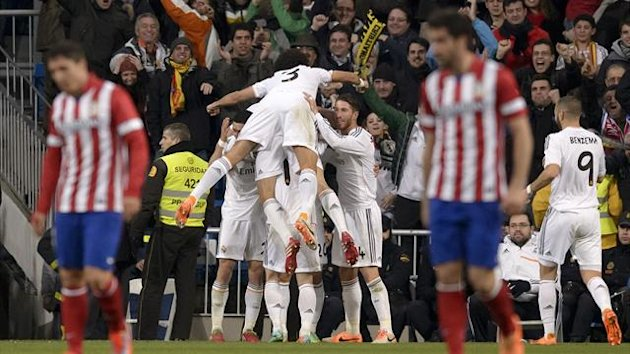 Real Madrid players celebrate against Atletico Madrid (AFP)