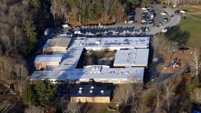 FILE - This Dec. 14, 2012 aerial file photo shows Sandy Hook Elementary School in Newtown, Conn., where a gunman shot 27 people dead, including 20 children. A task force of elected officials in Newtown on Friday, May 10, 2013 recommended tearing down the school and rebuilding on the same site. (AP Photo/Julio Cortez, File)