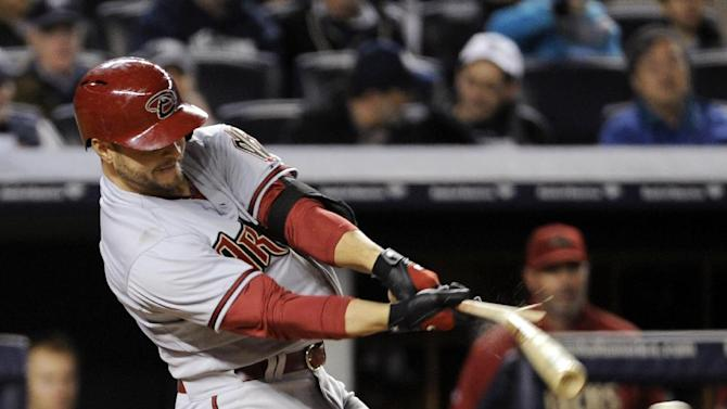 Arizona Diamondbacks' Cody Ross  breaks his bat as he grounds out during the sixth inning of a baseball game against the New York Yankees, Thursday, April 18, 2013, at Yankee Stadium in New York. (AP Photo/Bill Kostroun)