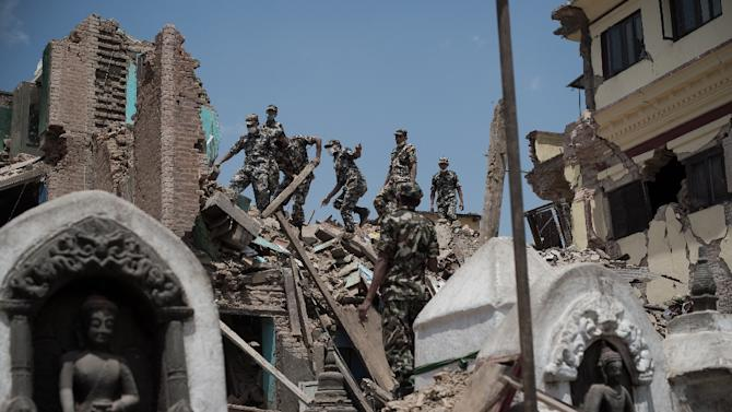 Nepalese soldiers clear rubble of a building at the damaged Swayambhunath temple in Kathmandu, on May 2, 2015