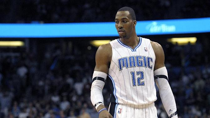 FILE -This file photo taken March 13, 2012, shows Orlando Magic center Dwight Howard during an NBA basketball game in Orlando, Fla. The Los Angeles Lakers have a deal in place to acquire Dwight Howard from Orlando in a four-team, eight-player trade also involving Denver and Philadelphia, and the NBA has scheduled a conference call Friday Aug. 10, 2012 with the four general managers to finish the deal, according to multiple reports. (AP Photo/Phelan M. Ebenhack, file)