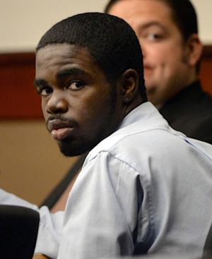 FILE - In this Tuesday, Aug. 27, 2013 file photo, De'Marquise Elkins appears in court during his trial in Marietta, Ga. Closing arguments began Friday, Aug. 30, 2013, in Elkins' trial. He is accused of fatally shooting a baby in a stroller in coastal Georgia. (AP Photo/Atlanta Journal-Constitution, Johnny Crawford, File)