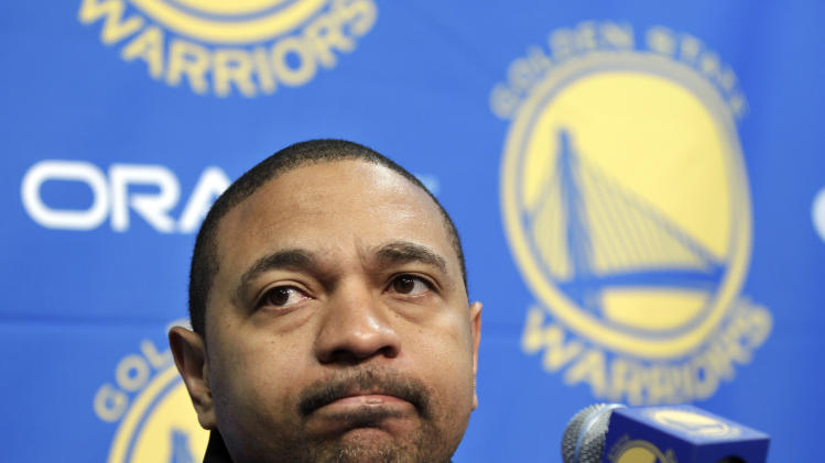 FILE - In this Dec. 1, 2011 file photo, Golden State Warriors head coach Mark Jackson listens during an NBA basketball news conference in Oakland, Calif. Jackson has confirmed that he and his family were the targets of an extortion scheme. The Smoking Gun reported that a 28-year-old former stripper possessed nude photographs of the married Warriors coach and wanted money to keep the photos from becoming public. The team confirmed two suspects were arrested earlier this week. (AP Photo/Paul Sakuma, File)