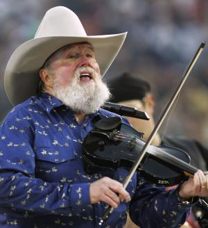 FILE - In this Feb. 6, 2005 file photo, Charlie Daniels performs during pre-game festivities before Super Bowl XXXIX between the New England Patriots and the Philadelphia Eagles at Alltel Stadium in Jacksonville, Fla. A representative for Charlie Daniels says the 76-year-old country singer is recovering after having a pacemaker implanted Thursday, March 28, 2013. (AP Photo/David J. Phillip, File)