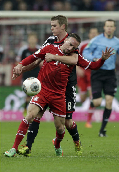 Bayern's Franck Ribery, front, and Leverkusen's Lars Bender challenge for the ball during the German first division Bundesliga soccer match between FC Bayern Munich and Bayer 04 Leverkusen, in