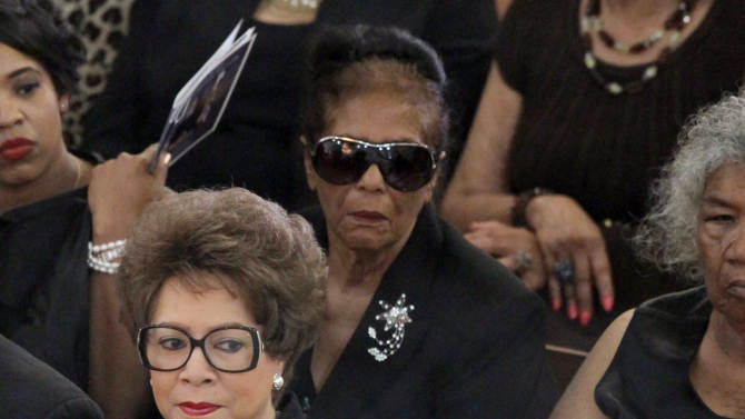 Mervyn Dymally's widow, Alice Gueno Dymally, left, looks toward her husband's coffin during funeral services Wednesday Oct. 17, 2012 in Culver City, Calif. Gov. Jerry Brown and dozens of other prominent officials attended the funeral of the trail-blazing leader, who in a four-decade career served in every corner of California government and eventually became the state's highest-ranking black politician. (AP Photo/Nick Ut)