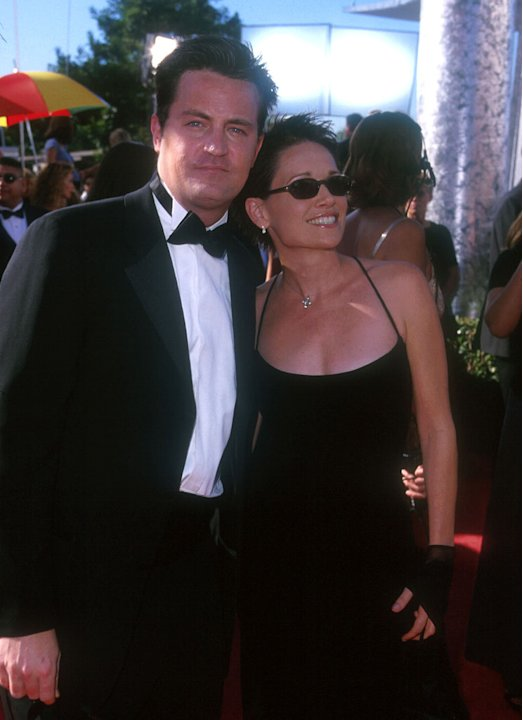 Matthew Perry and guest at The 51st Annual Primetime Emmy Awards.