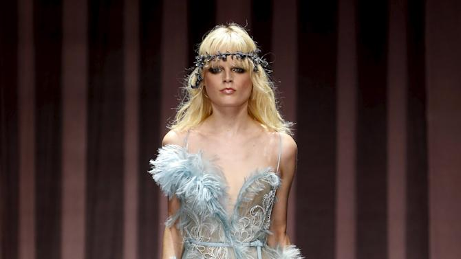 A model presents a creation by designer Italian designer Donatella Versace as part of her Haute Couture Fall Winter 2015/2016 fashion show in Paris