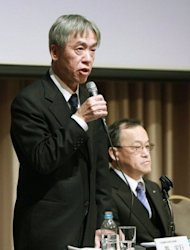Hiroyuki Sasa (L), newly appointed president of troubled Japanese optical maker Olympus, pictured next to the old president Shuichi Takayama at a press conference in Tokyo, on February. Olympus named current executive officer Sasa as its new president after one of the biggest financial scandals in Japanese corporate history