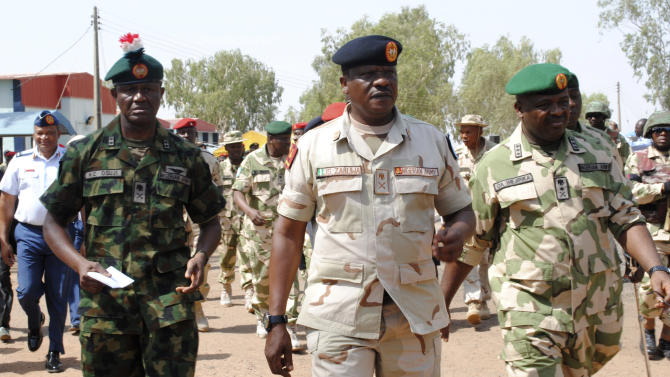 Maj. Gen. Kenneth Osuji, commander Nigeria Army peace keeping centre, left, Maj. Gen. John Zaruwa, commander Nigeria peace keeping centre, Lt.  Gen. Onyeabo Azubike Ihejirika, Nigeria chief of army staff, right, inspect Nigeria battalion 1 troops before their departure, at the peace keeping centre, in Jaji, Kaduna, Nigeria, Thursday, Jan. 17, 2013. The Federal Government has approved the immediate deployment of 900 troops as part of the ECOWAS  (Economic Community of West African States ) force to push for the emancipation of Northern Mali from the grip of Islamists. (AP Photo)