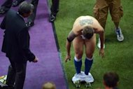 Italian forward Antonio Cassano takes off his shorts to give to a fan after the Euro 2012 football championships semi-final match against Germany at the National Stadium in Warsaw. Italy won 2-1