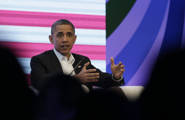 President Barack Obama participates in a three-way conversation with Brazil&#39;s President Dilma Rousseff and Colombia&#39;s President Juan Manuel Santos, not pictured, at the CEO Summit of the Americas, in Cartagena, Colombia, Saturday April 14, 2012. Regional business leaders are meeting parallel to the sixth Summit of the Americas which brings together presidents and prime ministers from Canada, the Caribbean, Latin America and the U.S. (AP Photo/Carolyn Kaster)