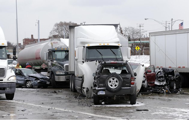 A section of multi-vehicle accident on Interstate 75 is shown in Detroit, Thursday, Jan. 31, 2013. Snow squalls and slippery roads led to a series of accidents that left at least three people dead and