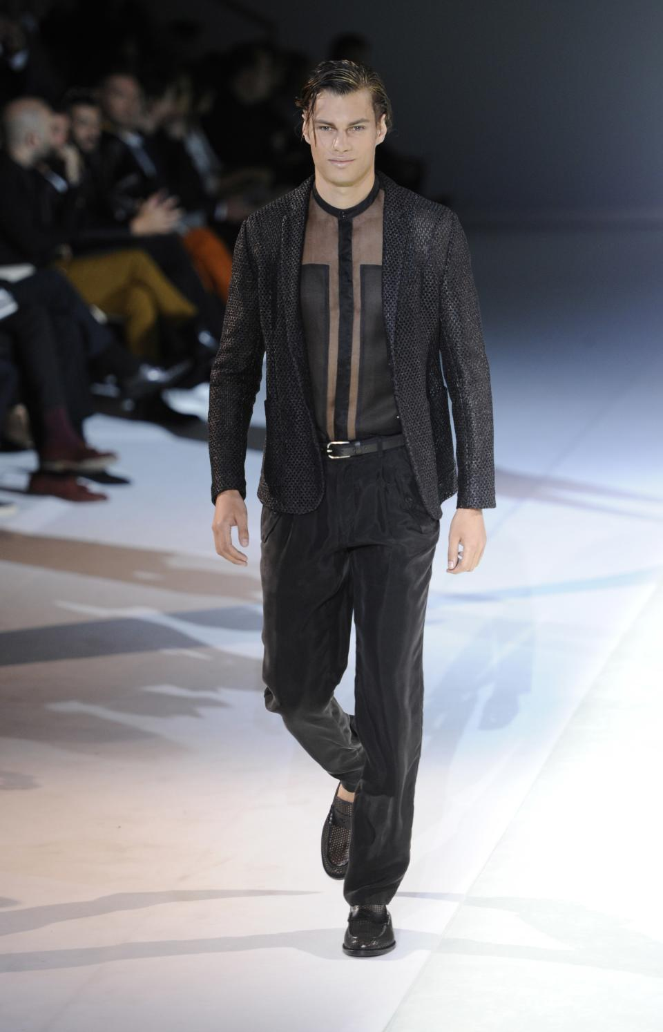 A model wears a creation for Emporio Armani men's Spring-Summer 2014 collection part of the Milan Fashion Week, unveiled in Milan, Italy, Monday, June 24, 2013. (AP Photo/Giuseppe Aresu)