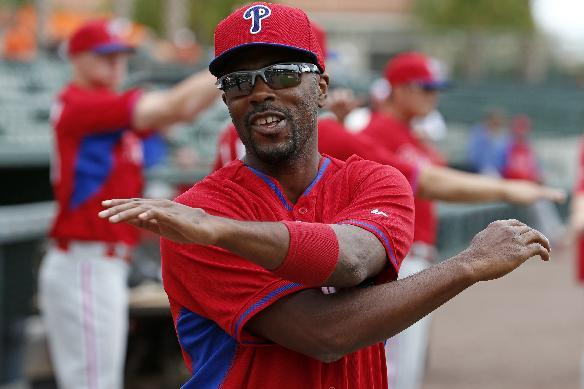 Philadelphia Phillies' Jimmy Rollins warms up before before an exhibition spring training baseball game against the Baltimore Orioles in Sarasota, Fla., Friday, March 7, 2014