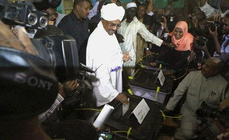 Sudan's President Omar Hassan al-Bashir casts his ballot during elections in the capital Khartoum