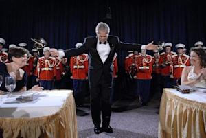 U.S. President Bush takes a bow after conducting the Marine Band at the annual White House Correspondents Association dinner in Washington