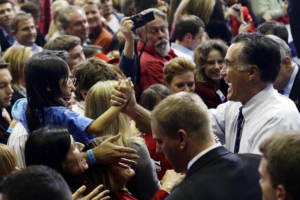 Republican presidential candidate and former Massachusetts Gov. Mitt Romney greets a young girl as he greets supporters at a Virginia campaign rally at The Patriot Center at George Mason University, in Fairfax, Va., Monday, Nov. 5, 2012. (AP Photo/Charles Dharapak)