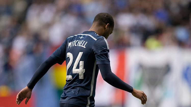 Vancouver Whitecaps' Carlyle Mitchell, of Trinidad and Tobago, limps off the field with an injury during the second half of an MLS soccer game against Chivas USA in Vancouver, British Columbia, Saturday, July 12, 2014. (AP Photo/The Canadian Press, Darryl Dyck)