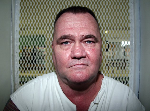 In this Aug. 29, 2012, photo, convicted killer Cleve Foster speaks from a visiting cage at the Texas Department of Criminal Justice Polunsky Unit outside Livingston, Texas. Foster has received three reprieves from the U.S. Supreme Court, including two last year when he was within hours of execution for the slaying of a 30-year-old woman near Fort Worth in 2000. He is scheduled to die Sept. 25, 2012. (AP Photo/Michael Graczyk)