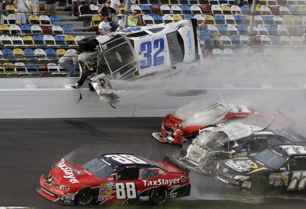 Kyle Larson (32) goes airborne and into the catch fence in a multi-car crash involving Dale Earnhardt Jr. (88), Parker Kilgerman (77), Justin Allgaier (31) and Brian Scott (2) during the final lap of
