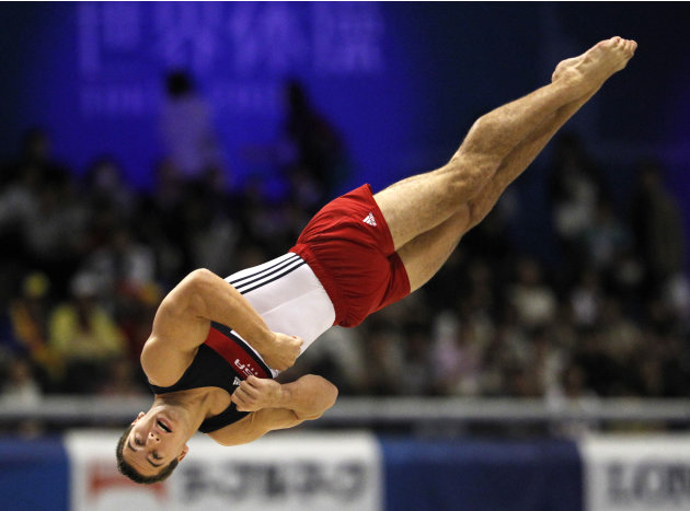 USA's Jacob Dalton performs during the final of the men's floor exercise  at  the Artistic Gymnastics World Championships in Tokyo, Japan, Saturday, Oct. 15, 2011. (AP Photo/Koji Sasahara)