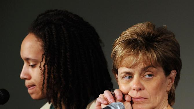 Baylor head women's coach Kim Mulkey, right, listens while sitting with Brittney Griner, left, during a news conference in Waco, Texas, Thursday, March 29, 2012.  Mulkey announced she is diagnosed with Bell's Palsy. Baylor will play Stanford in an NCAA tournament Final Four semifinal college basketball game on Sunday. (AP Photo/Waco Tribune Herald, Rod Aydelotte)