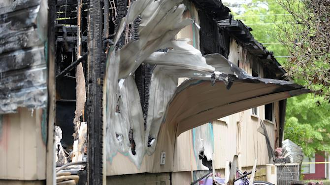 Peeled and charred siding is evidence of a fatal house fire that killed five, including four children, in Newnan, Ga., Saturday, April 27, 2013. The fire killed Alonna T. McCrary, 27, as well as her 5-year-old daughter Eriel McCrary and 2-year-old daughter Nikia White, according to Glenn Allen, the Georgia state Insurance commissioner's spokesman. Two other children, Messiah White, 3, and McKenzie Florence, 2, also died. Allen said the two were sleeping over at the home. A fifth child, 11-year-old Nautica McCrary, escaped the burning home and was taken to a hospital to be treated for smoke inhalation. (AP Photo/David Tulis)
