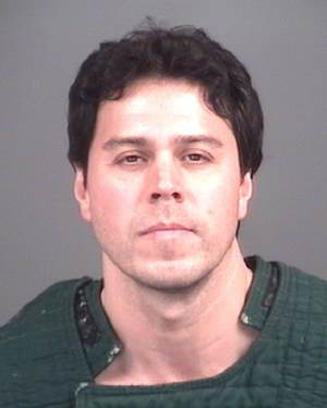 In a photo provided by the Livingston County Sheriff, Raulie Wayne Casteel is shown in a booking mug, Wednesday, Nov. 7, 2012 in Howell, Mich. Michigan prosecutors have charged the 43-year-old man suspected in a shooting spree along a 100-mile stretch of roads with assault with a dangerous weapon and other gun charges.  (AP Photo/Livingston County Sheriff)