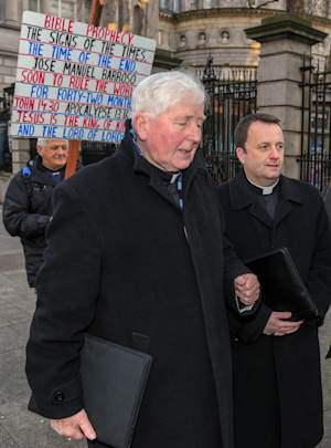 Bishop Christopher Jones, left, and Father Timothy Burke arrive  to attend a  parliamentary committee on abortion in Dublin Thursday Jan. 10, 2013.  A poll suggests that most people in Ireland want their lawmakers to give clearer and wider access to abortion in a bill due to be unveiled this year. The survey was published Thursday as senior figures from several churches testified to a parliamentary committee investigating possible reforms to Ireland's ban on abortion. (AP Photo/ Barry Cronin/PA) UNITED KINGDOM OUT