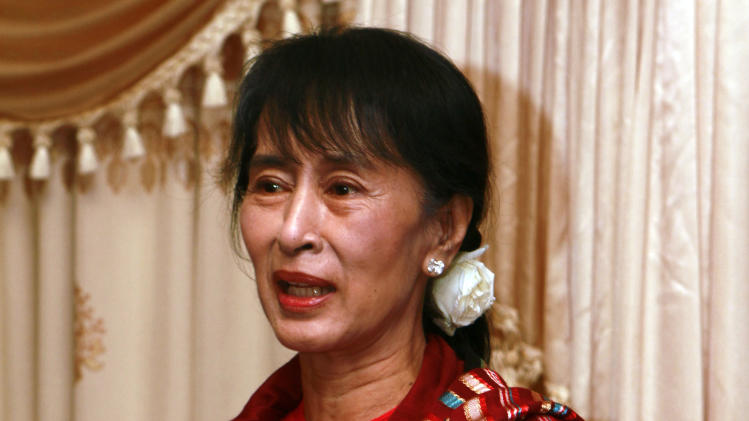 Myanmar pro-democracy leader Aung San Suu Kyi holds talks with Myanmar parliament members at a hotel in Naypyitaw, Myanmar Tuesday, March 6, 2012.  (AP Photo/Khin Maung Win, Pool)