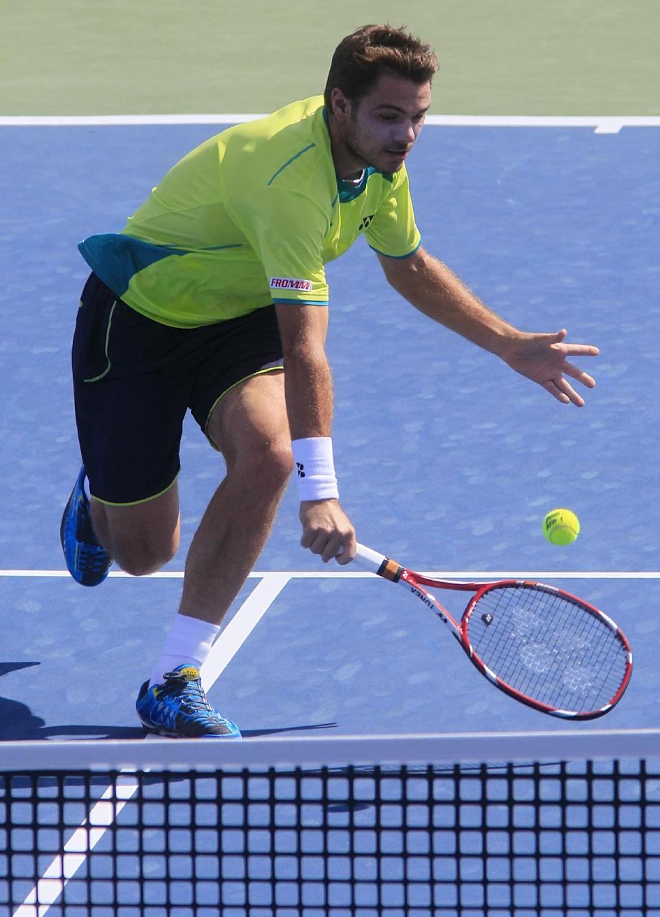 Stanislas Wawrinka, from Switzerland, volleys against Milos Raonic, from Canada, during a quarterfinal at the Western & Southern Open tennis tournament on Friday, Aug. 17, 2012, in Mason, Ohio. (AP Photo/Al Behrman)