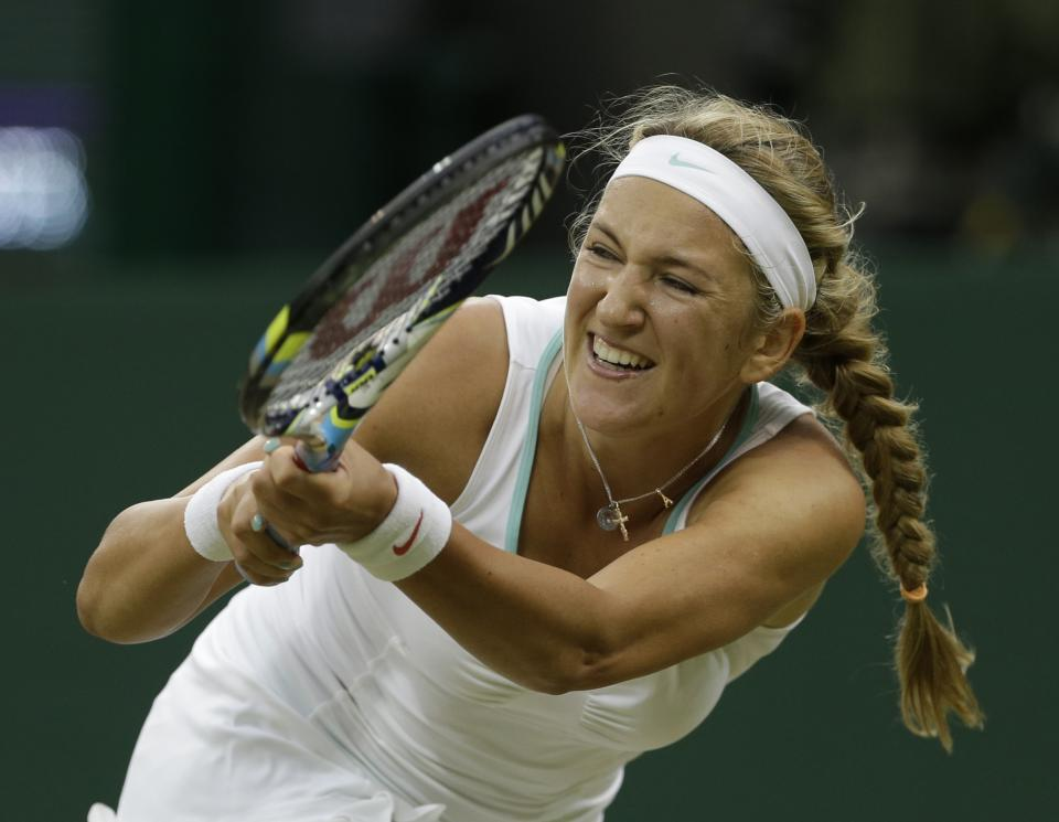 Victoria Azarenka of Belarus plays a return to Ana Ivanovic of Serbia during a fourth round singles match at the All England Lawn Tennis Championships at Wimbledon, England, Monday, July 2, 2012. (AP Photo/Anja Niedringhaus)
